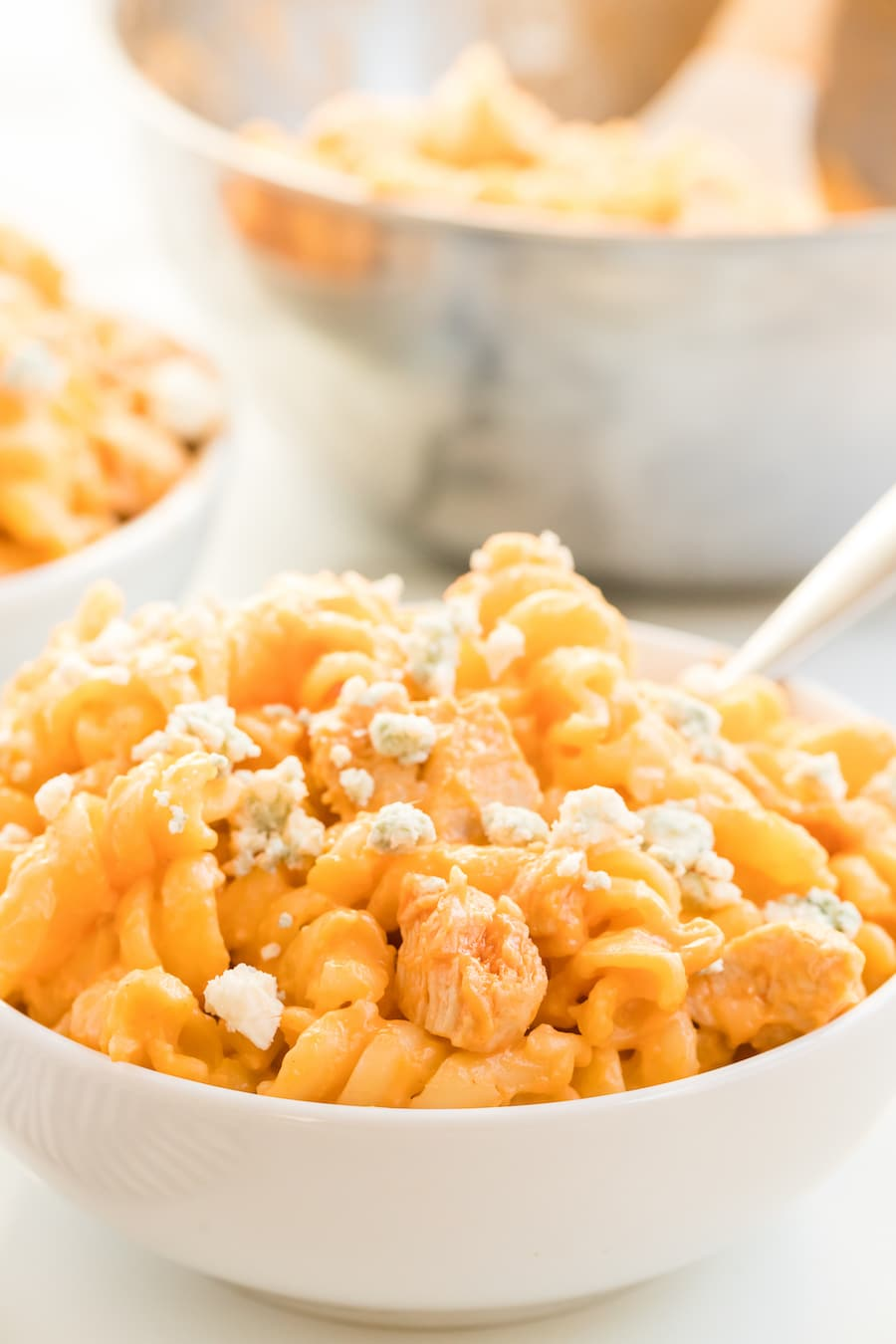 Macaroni and cheese with buffalo chicken and blue cheese crumbles