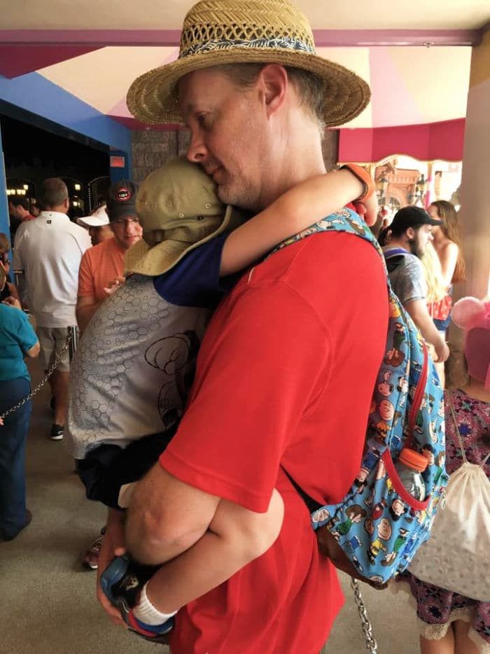 Dad holding toddler at Disney World