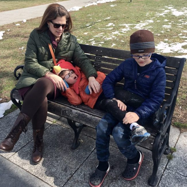 Mom and kids on a park bench
