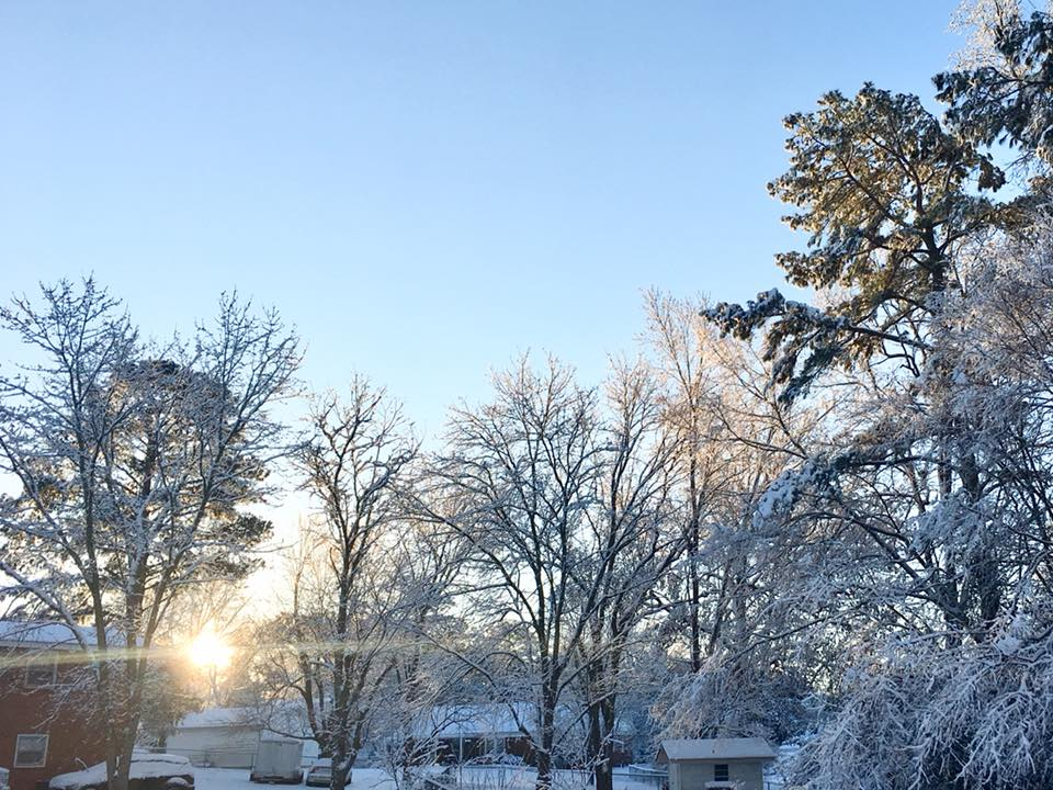 sunrise with blue sky and snow