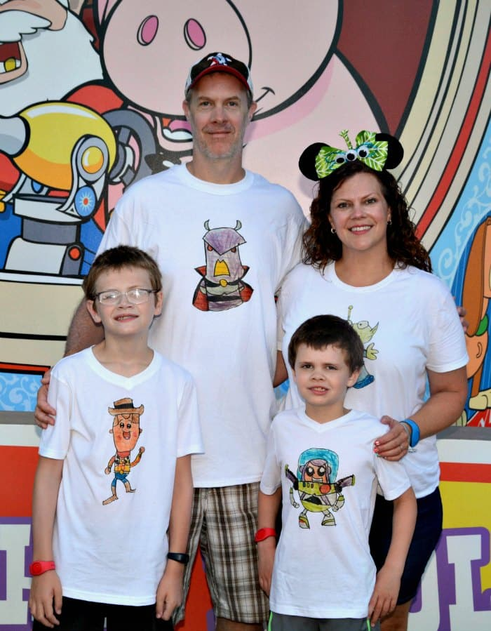 Wearing our Disney family shirts at Toy Story Land at Disney World 6926cddaa