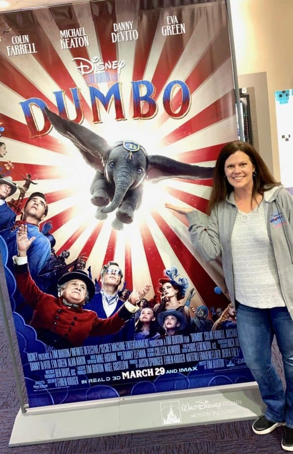 Standing next to Dumbo Poster at Theater