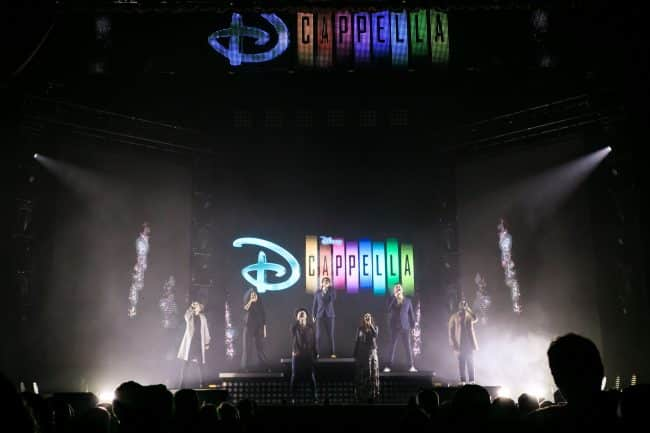 DCappella on stage with logo