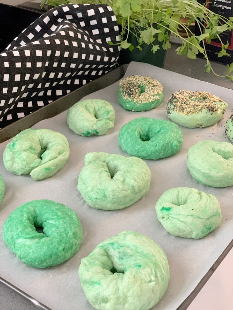 green bagels on baking sheet