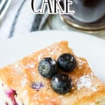 Blueberry Breakfast Cake on plate with coffee