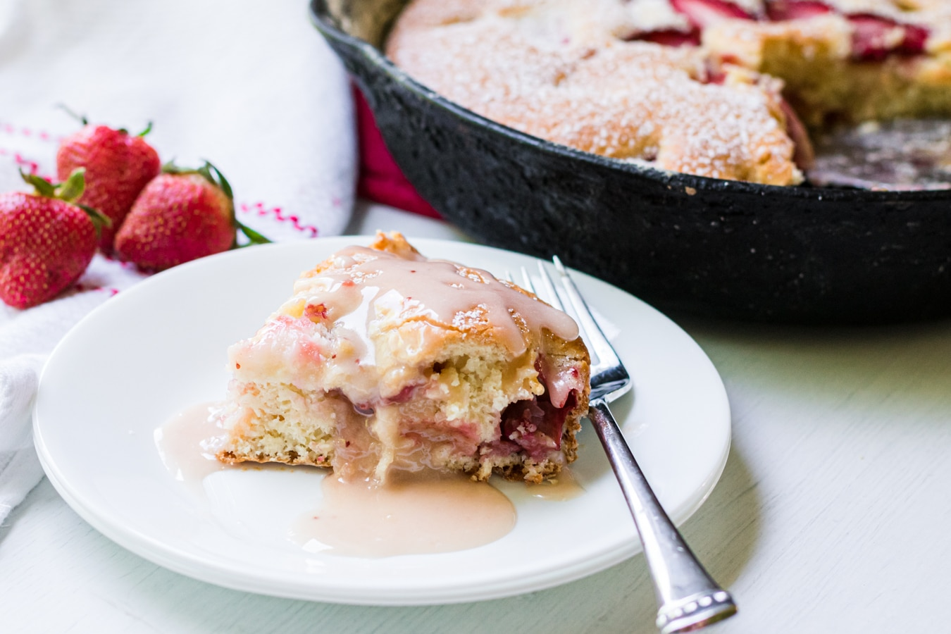 slice of cake in front of Strawberry Skillet Cake
