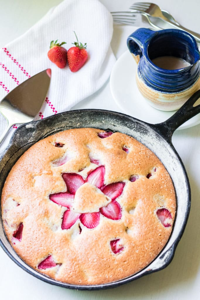 cooked strawberry cake in a cast iron pan