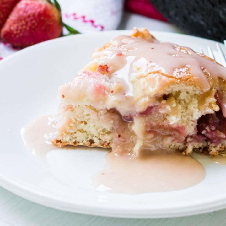strawberry glazed cake on plate