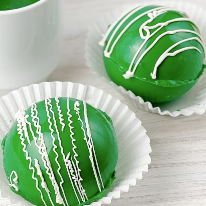 Green Hot Cocoa Bombs in paper liners