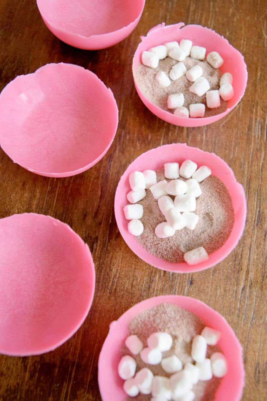 candy half-spheres filled with dry hot cocoa and marshmallows