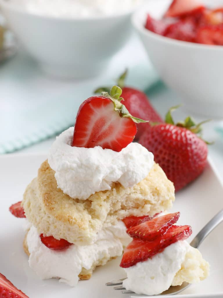 strawberry shortcake on a plate with a bite