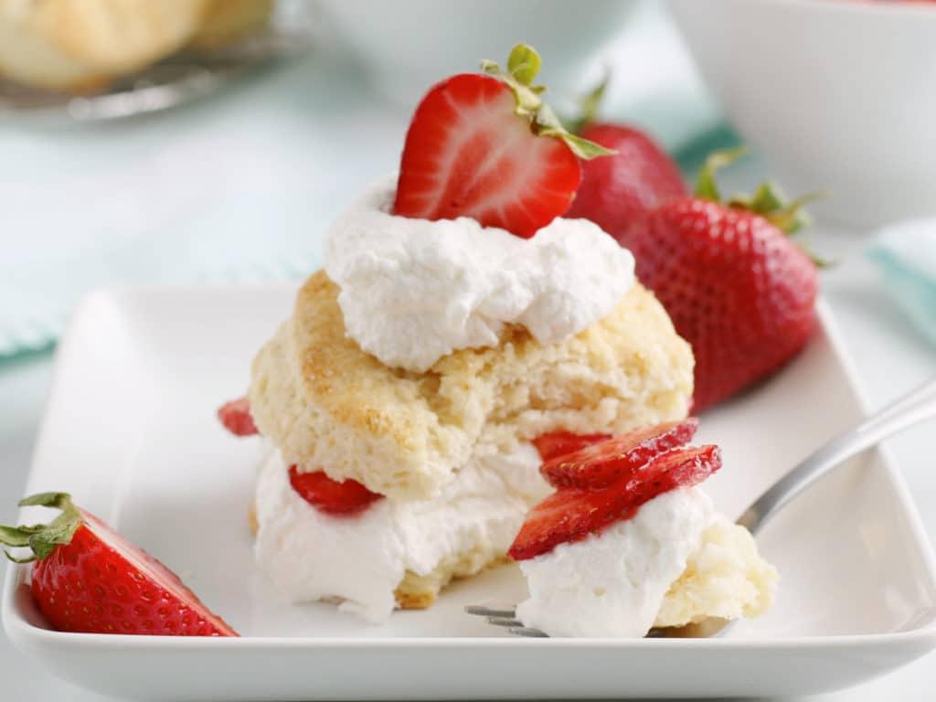 strawberry shortcake with bite on fork
