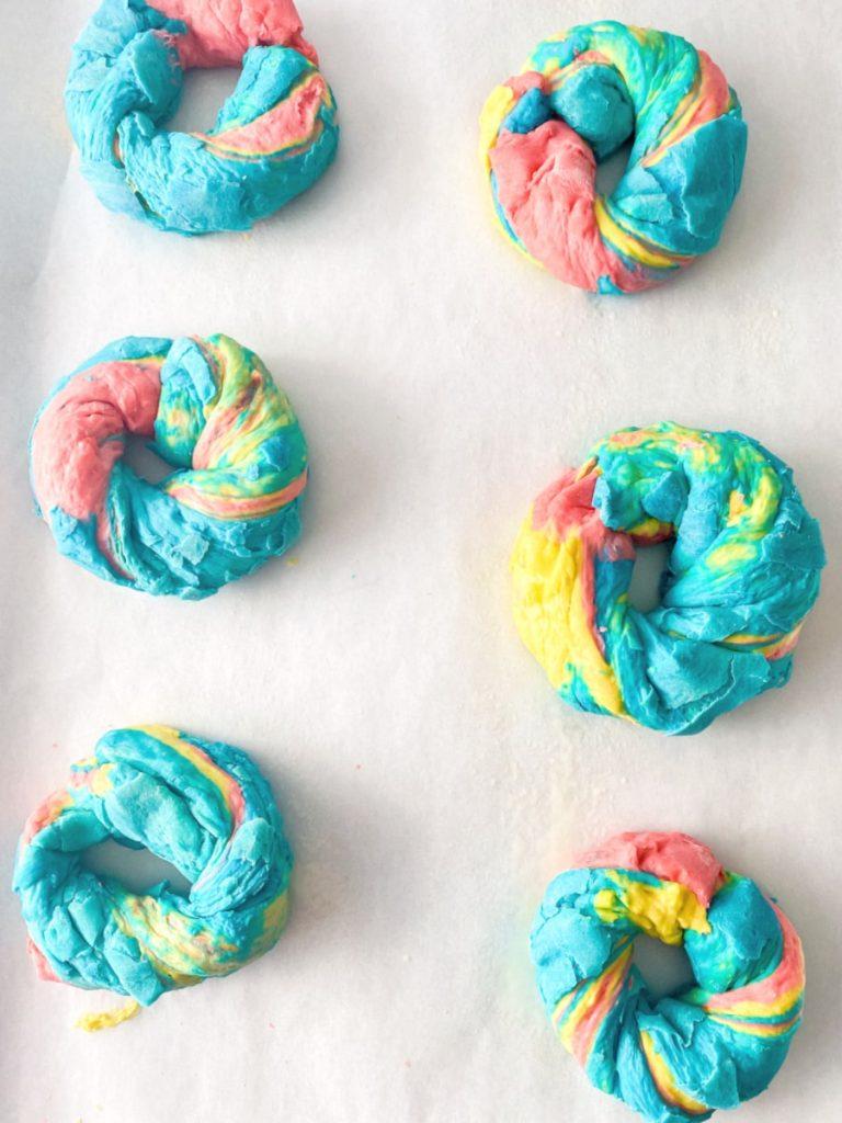 rainbow bagels on sheet