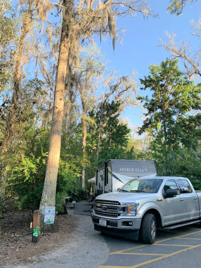 truck and motor home parked in camp spot