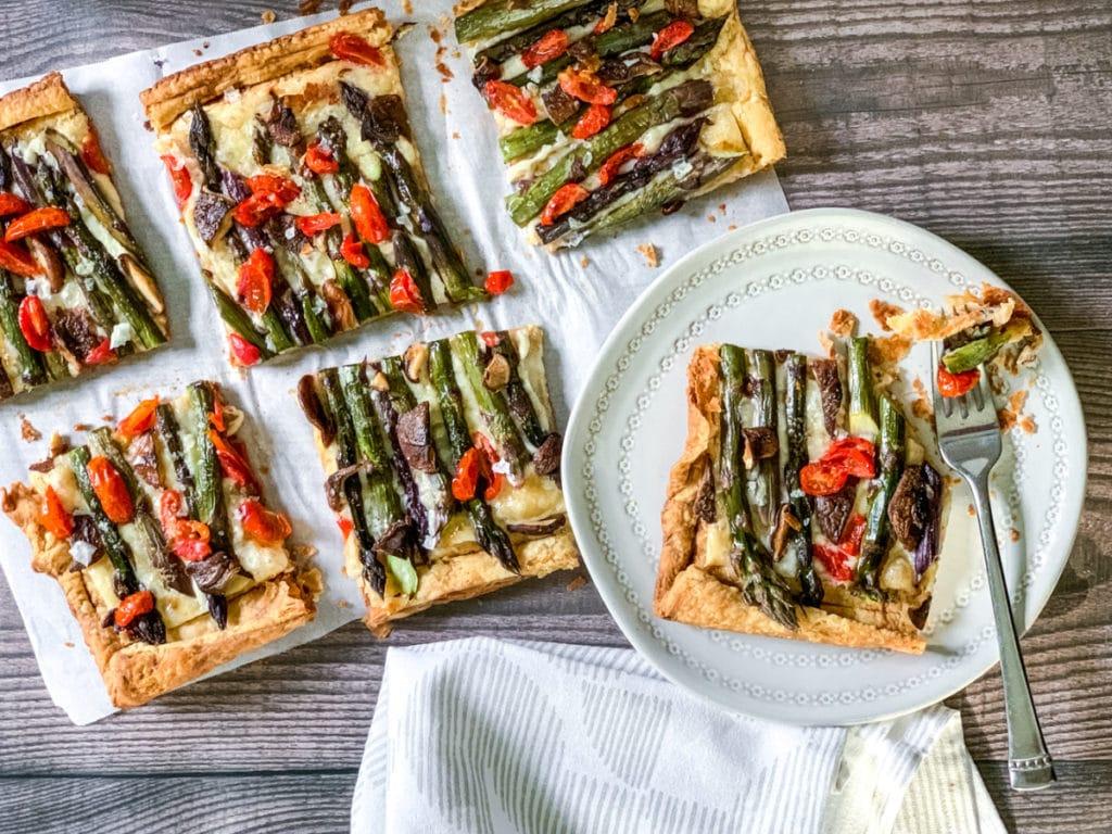 asparagus tart sliced with bite on fork