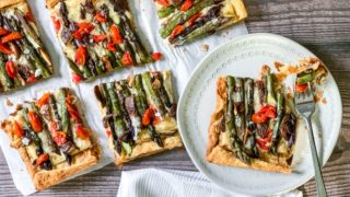 asparagus tart sliced with bite on fork