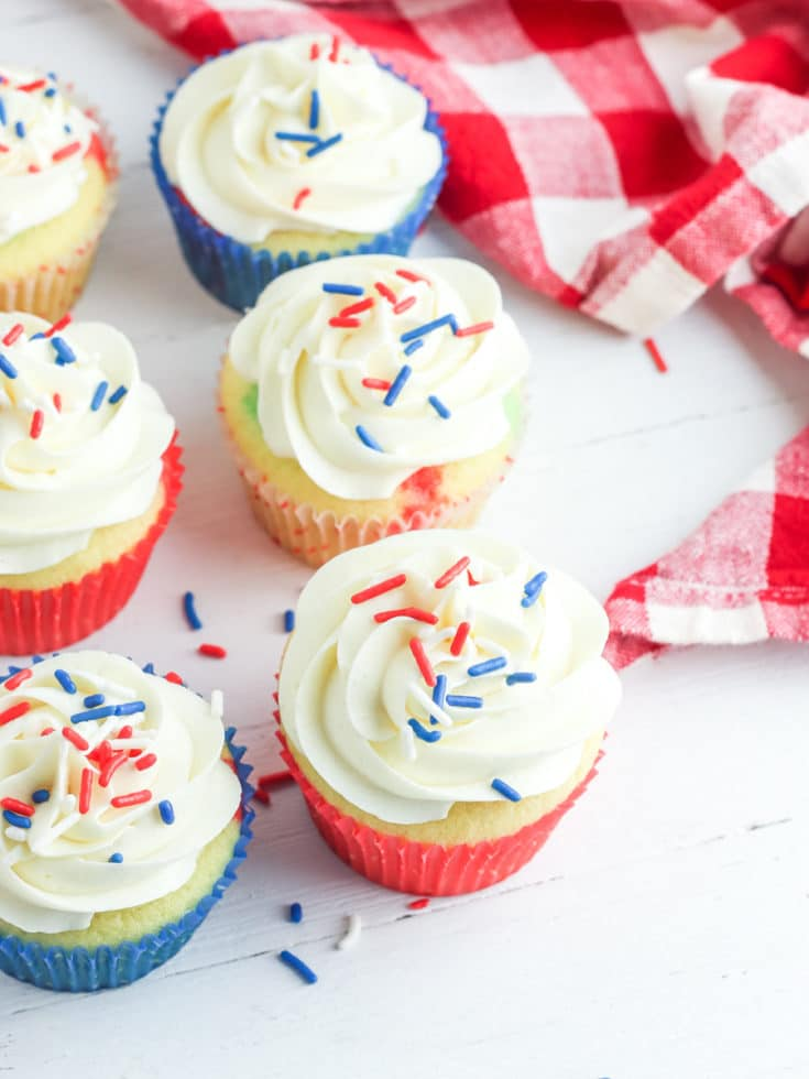 red white and blue cupcakes for july 4th on counter