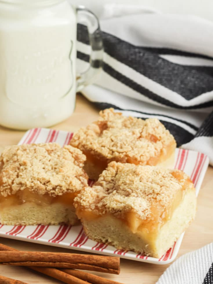Apple Pie Bars on a plate with a glass of milk