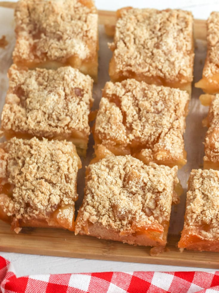 Apple Pie Bars sliced and cooling on wood cutting board