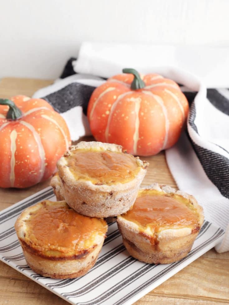 cinnamon roll pumpkin pie bites on plate