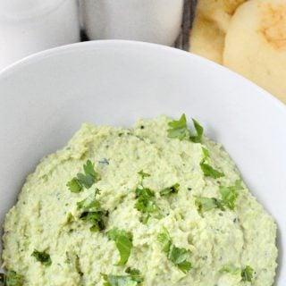 edamame hummus in bowl with cilantro