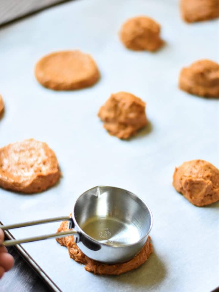 flatten cookies with back of scoop