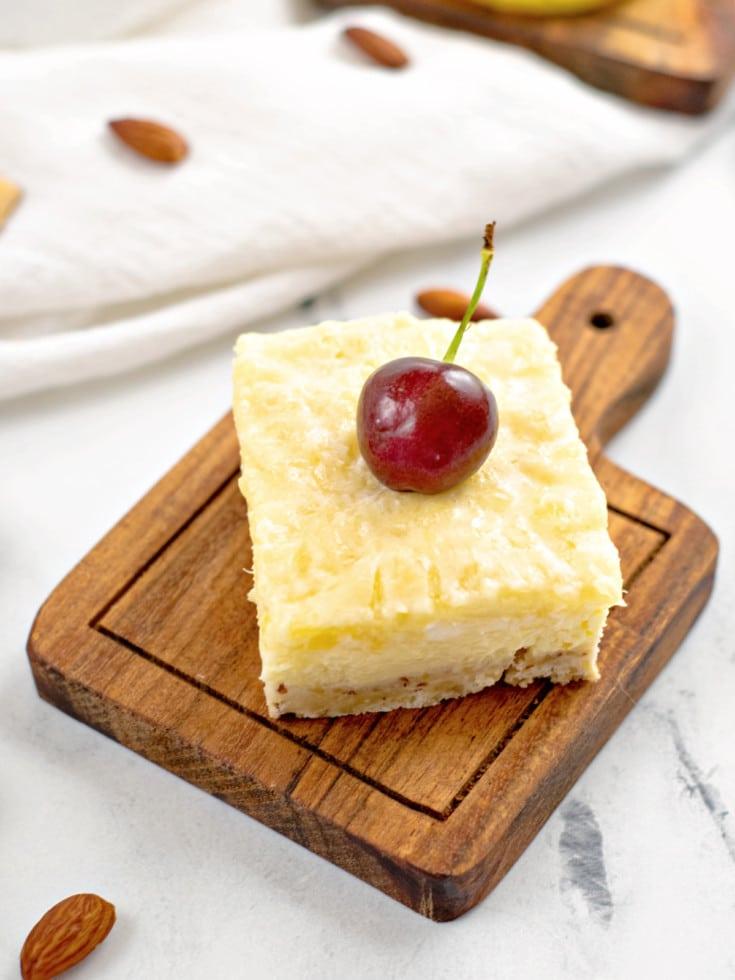 Pineapple Cheesecake Bar sliced with cherry
