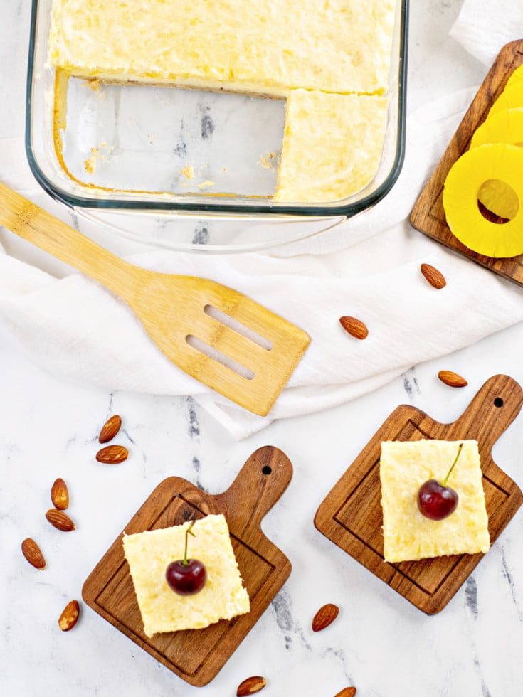cheesecake bars with cherry sliced